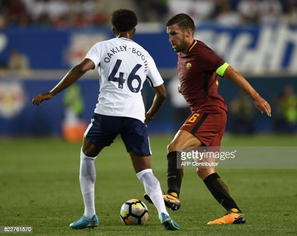Kevin Strootman of AS Roma vies for the ball with Tashan OakleyBoothe of Tottenham Hotspur during the International Champions Cup football match...