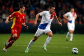 Kevin Strootman of Netherlands and Alexandru Bourceanu of Romania battle for the ball during the the Group 4 FIFA 2014 World Cup Qualifier match...