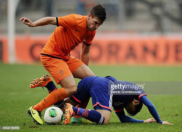 Kevin Strootman of Netherlands challenges Shinji Kagawa of Japan during the International Friendly match between the Netherlands and Japan on...