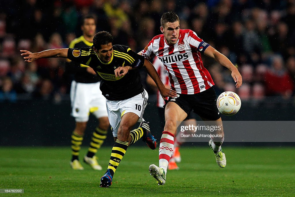Kevin Strootman of PSV and Celso Borges of AIK battle for the ball during the UEFA Europa League Group F match between PSV Eindhoven and AIK Solna at the Philips Stadion on October 25, 2012 in Eindhoven, Netherlands.