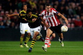 Kevin Strootman of PSV and Celso Borges of AIK battle for the ball during the UEFA Europa League Group F match between PSV Eindhoven and AIK Solna at...