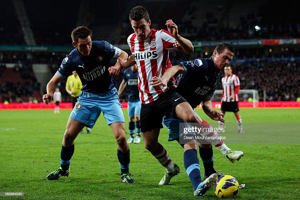 Kevin Strootman of PSV battles for the ball with Wesley Verhoek (R) and Stefan de Vrij (L) of Feyenoord during the KNVB Dutch Cup match between PSV Eindhoven and Feyenoord Rotterdam at Philips Stadion on January 30, 2013 in Eindhoven, Netherlands.