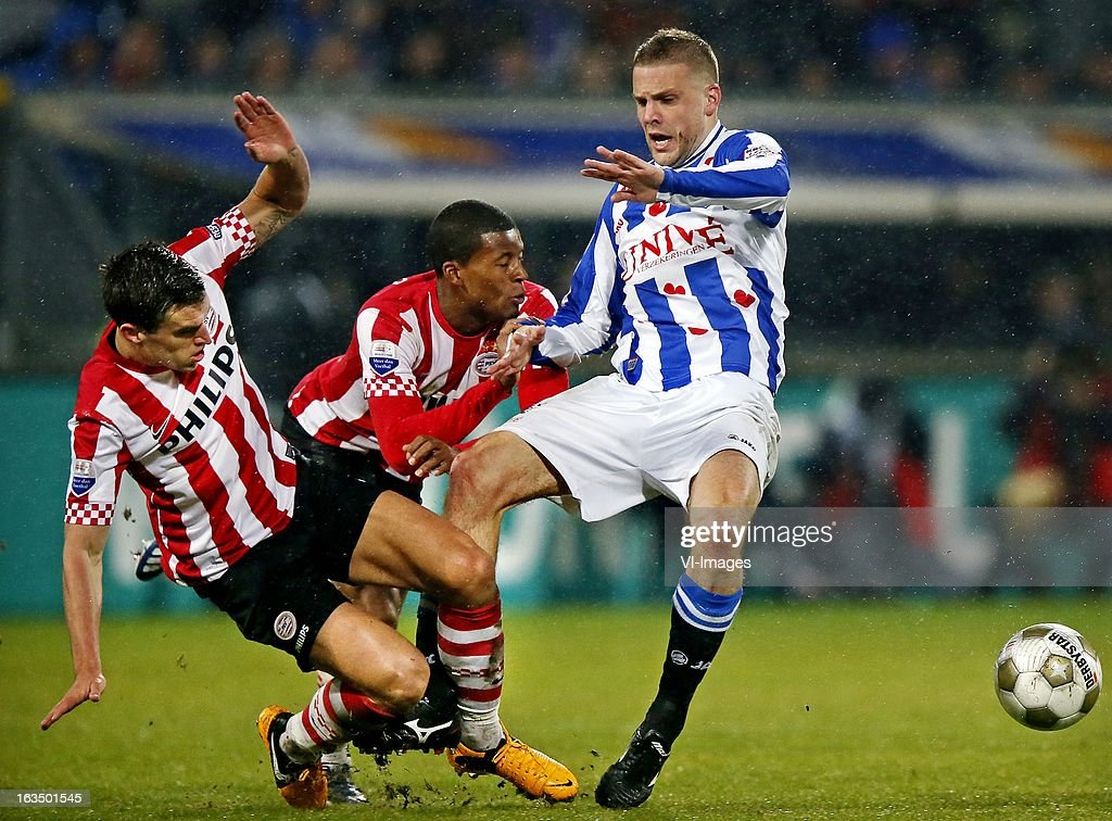 Kevin Strootman of PSV, Giorginio Wijnaldum of PSV, Joey van den Berg of Heerenveen during the Dutch Eredivisie match between SC Heerenveen and PSV Eindhoven at the Abe Lenstra Stadium on march 09, 2013 in Heerenveen, The Netherlands
