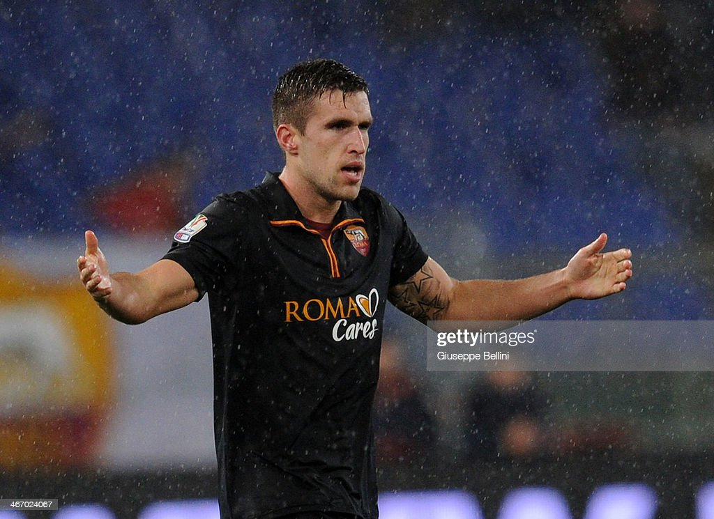 <a gi-track='captionPersonalityLinkClicked' href=/galleries/search?phrase=Kevin+Strootman&family=editorial&specificpeople=5566501 ng-click='$event.stopPropagation()'>Kevin Strootman</a> of Roma celebrates after scoring the goal to go up 2-0 during the TIM Cup match between AS Roma and SSC Napoli at Olimpico Stadium on February 5, 2014 in Rome, Italy.