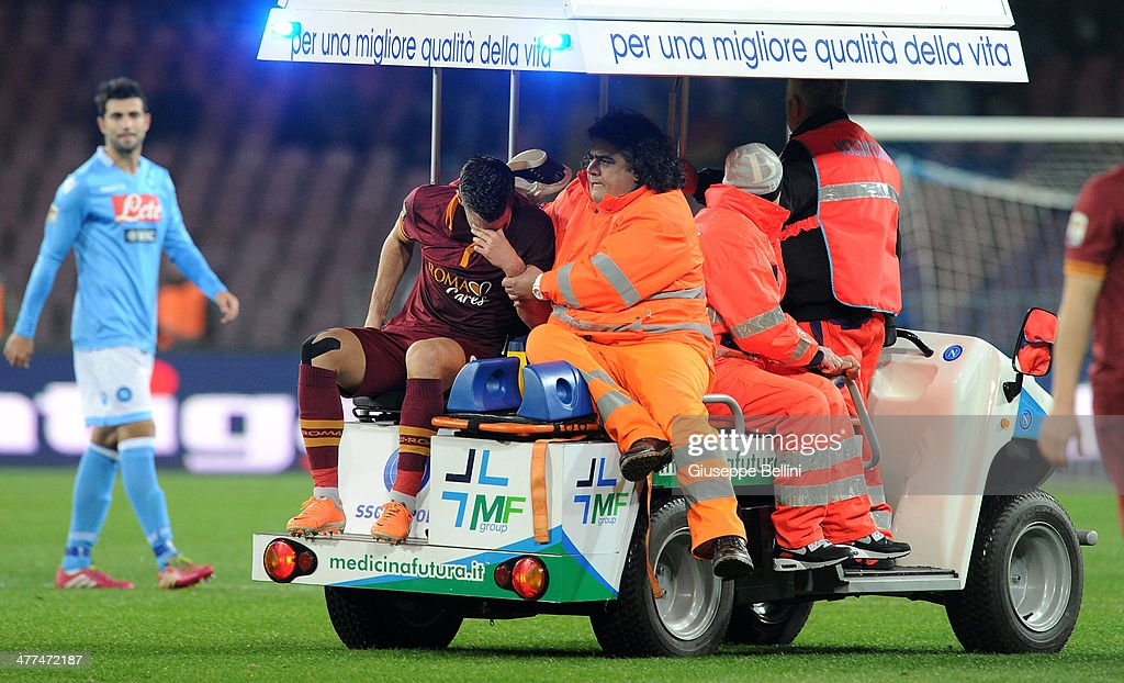 <a gi-track='captionPersonalityLinkClicked' href=/galleries/search?phrase=Kevin+Strootman&family=editorial&specificpeople=5566501 ng-click='$event.stopPropagation()'>Kevin Strootman</a> of Roma goes off injured during the Serie A match between SSC Napoli and AS Roma at Stadio San Paolo on March 9, 2014 in Naples, Italy.