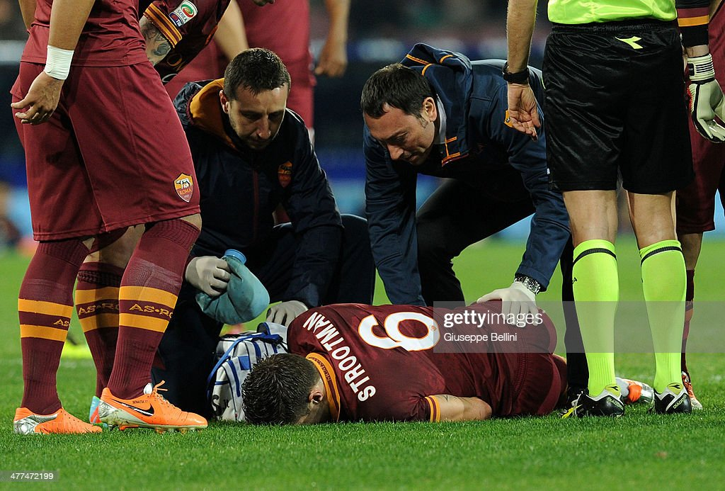 <a gi-track='captionPersonalityLinkClicked' href=/galleries/search?phrase=Kevin+Strootman&family=editorial&specificpeople=5566501 ng-click='$event.stopPropagation()'>Kevin Strootman</a> of Roma lies injured during the Serie A match between SSC Napoli and AS Roma at Stadio San Paolo on March 9, 2014 in Naples, Italy.
