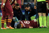 Kevin Strootman of Roma lies injured during the Serie A match between SSC Napoli and AS Roma at Stadio San Paolo on March 9 2014 in Naples Italy