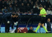 Kevin Strootman of Roma lies injured on the pitch during the Serie A match between SSC Napoli and AS Roma at Stadio San Paolo on March 9 2014 in...