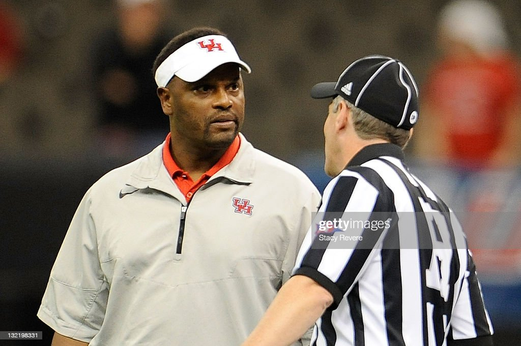 Kevin Sumlin, head coach of the University of Houston Cougars discusses a call with an official during a game against the Tulane Green Wave being held at the Mercedes-Benz Superdome on November 10, 2011 in New Orleans, Louisiana.