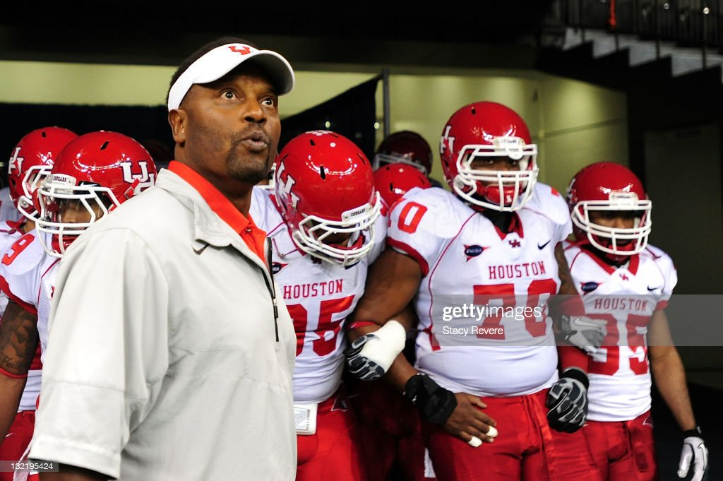 Kevin Sumlin, head coach of the University of Houston Cougars waits to take the field against the Tulane Green Wave at the Mercedes-Benz Superdome on November 10, 2011 in New Orleans, Louisiana.