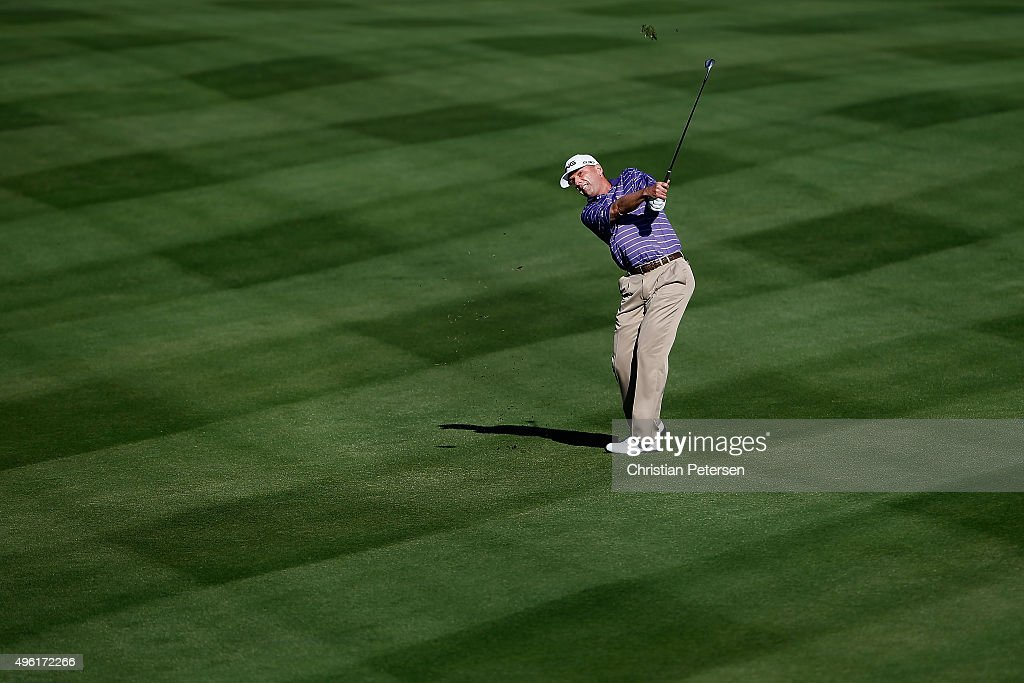 Kevin Sutherland plays his second shot on the 14th hole during the third round of the Charles Schwab Cup Championship on the Cochise Course at The...