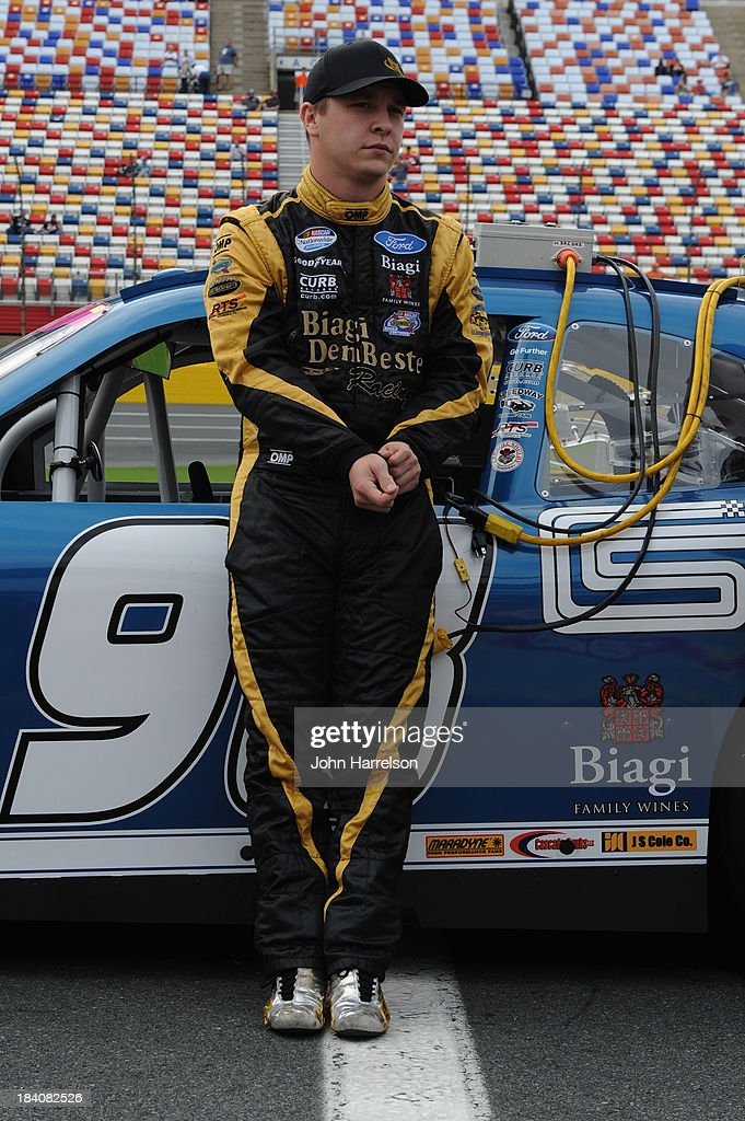 Kevin Swindell, driver of the #98 Carroll Shelby Engine Company Ford, stands on the grid during qualifying for the NASCAR Nationwide Series Dollar General 300 at Charlotte Motor Speedway on October 11, 2013 in Concord, North Carolina.