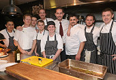 Kevin Systrom poses with chefs at a party hosted by Instagram's Kevin Systrom and Jamie Oliver This is their second annual private party taking place...