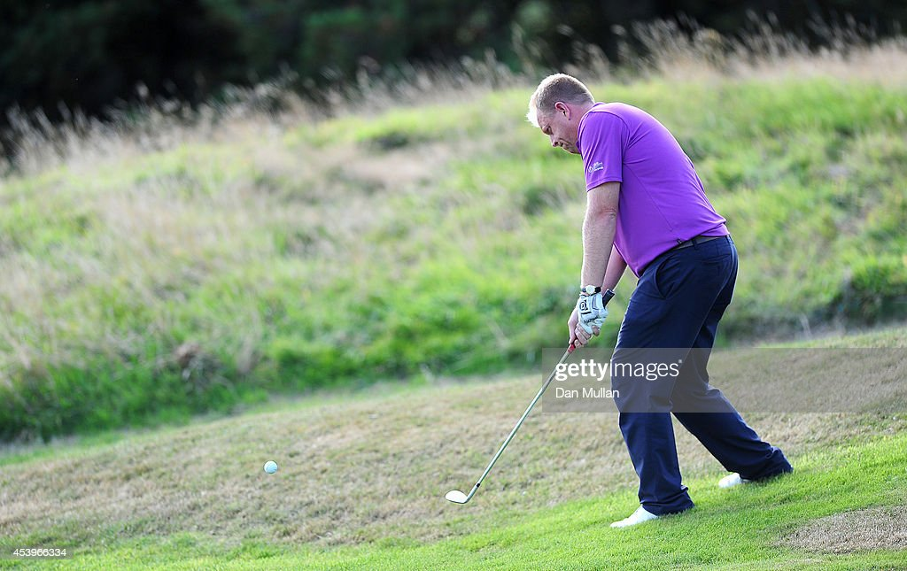 Kevin Taylor of Brailsford Golf Course plays a shot on the 17th hole during day three of the Golfbreakscom PGA Fourball Championship at St Mellion...