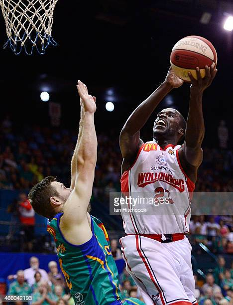 Kevin Tiggs of the Hawks attempts a layup past Mitch Norton of the Crocodiles during the round 16 NBL match between the Townsville Crocodiles and the...