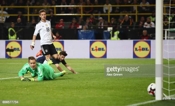 Kevin Trapp of Germany watches on as Adam Lallana of England hits the post during the international friendly match between Germany and England at...