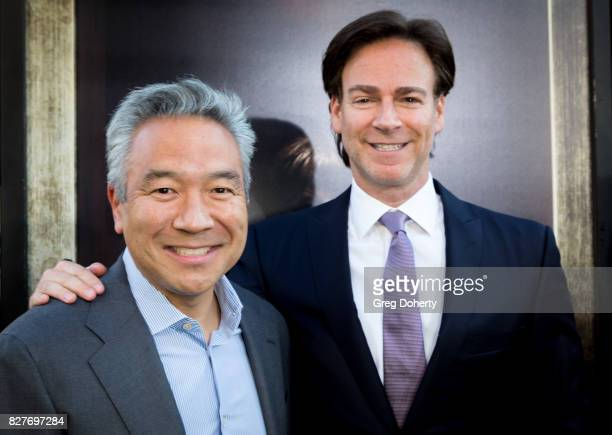Kevin Tsujihara Chairman and CEO of Warner Bros and David Sandberg Director arrive for the Premiere Of New Line Cinema's 'Annabelle Creation' at the...