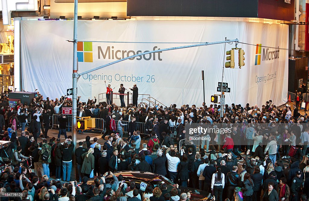 Kevin Turner, chief operating officer of Microsoft Corp., stage right, Panos Panay, general manager of Microsoft Surface, center, and Melinda George, Times Square store manager, attend the Microsoft Corp. store grand opening in New York, U.S., on Thursday, Oct. 25, 2012. Microsoft Corp. introduced the biggest overhaul of its flagship Windows software in two decades, reflecting the rising stakes in its competition with Apple Inc. and Google Inc. for the loyalty of customers who are shunning personal computers and flocking to mobile devices. Photographer: Ramin Talaie/Bloomberg via Getty Images