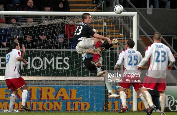 Kevin Twaddle of Falkirk crashes into Rangers goal keeper Allan McGregor Bank of Scotland Premier League Falkirk v Rangers The Falkirk StadiumFalkirk