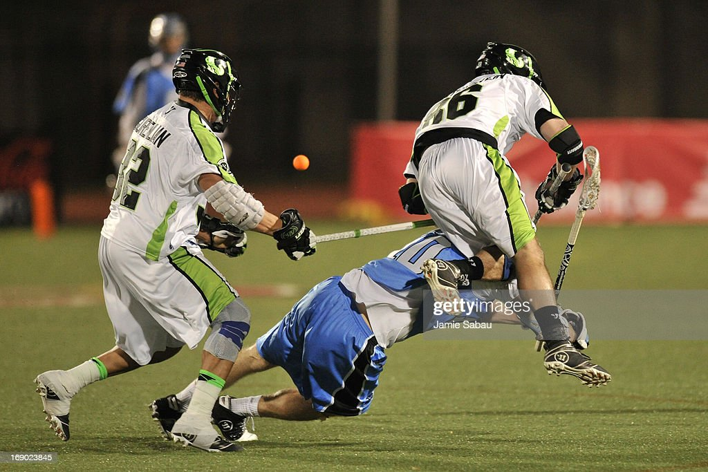 Kevin Unterstein #86 of the New York Lizards flies over the top of Eric O'Brien #10 of the Ohio Machine as they chase after a loose ball with Greg Gurenlian #32 of the New York Lizards in the fourth period on May 18, 2013 at Selby Stadium in Delaware, Ohio. New York defeated Ohio 14-8.