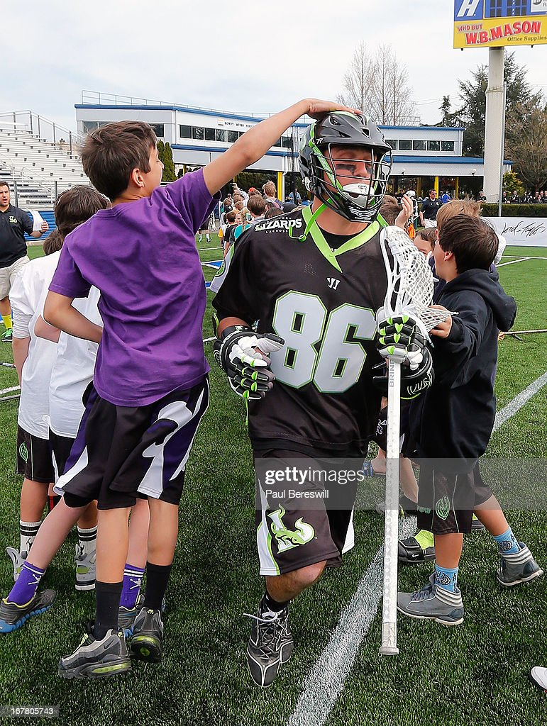 Kevin Unterstein #86 of the New York Lizards is shown running onto the field during introductions before a Major League Lacrosse game against the Boston Cannons at James M. Shuart Stadium on April 28, 2013 in Hempstead, New York.