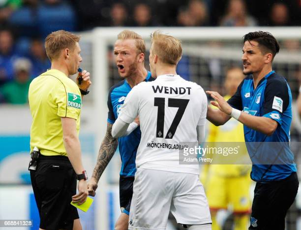 Kevin Vogt of 1899 Hoffenheim chats to referee Christian Dingert during the Bundesliga match between TSG 1899 Hoffenheim and Borussia...