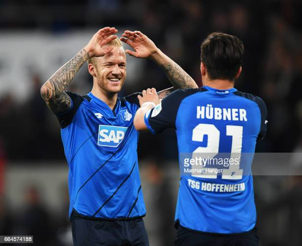 Kevin Vogt of 1899 Hoffenheim congratulates Benjamin Huebner after victory in the Bundesliga match between TSG 1899 Hoffenheim and Bayern Muenchen at...