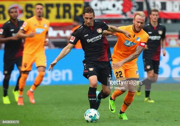 Kevin Vogt of Hoffenheim and Dominik Kohr of Leverkusen battle for the ball during the Bundesliga match between Bayer 04 Leverkusen and TSG 1899...