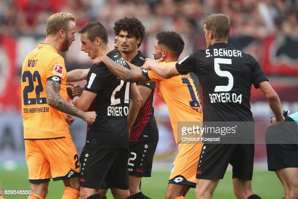 Kevin Vogt of Hoffenheim and Dominik Kohr of Leverkusen have a dispute after a foul at Sandro Wagner during the Bundesliga match between Bayer 04...