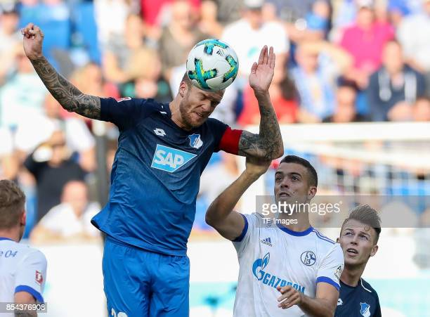 Kevin Vogt of Hoffenheim and Franco Matias Di Santo of Schalke battle for the ball during the Bundesliga match between TSG 1899 Hoffenheim and FC...