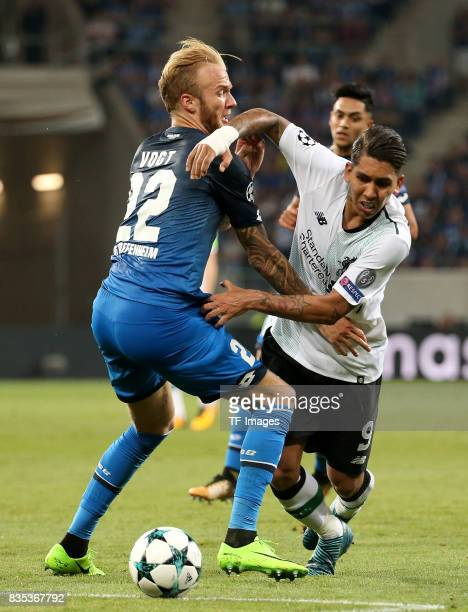 Kevin Vogt of Hoffenheim and Roberto Firmino of Liverpool battle for the ball during the UEFA Champions League Qualifying PlayOffs Round First Leg...