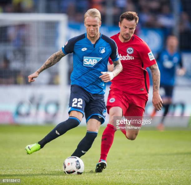 Kevin Vogt of Hoffenheim is challenged by Aymane Barkok of Frankfurt during the Bundesliga match between TSG 1899 Hoffenheim and Eintracht Frankfurt...