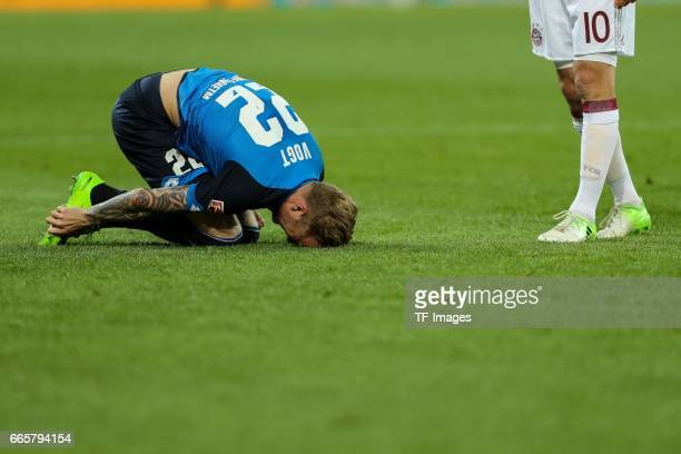 Kevin Vogt of Hoffenheim on the ground during the Bundesliga match between TSG 1899 Hoffenheim and Bayern Muenchen at Wirsol RheinNeckarArena on...