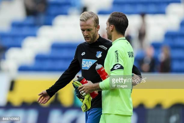 Kevin Vogt of Hoffenheim speak with Goalkeeper Oliver Baumann of Hoffenheim during the Bundesliga match between TSG 1899 Hoffenheim and Hertha BSC at...