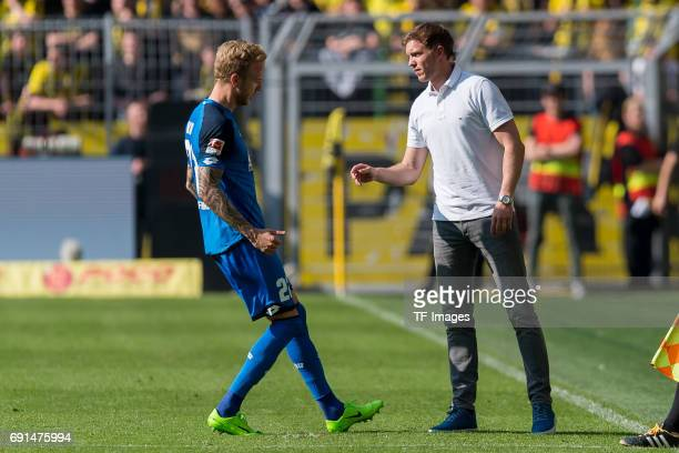 Kevin Vogt of Hoffenheim speak with Head coach Julian Nagelsmann of Hoffenheim during the Bundesliga match between Borussia Dortmund and TSG 1899...