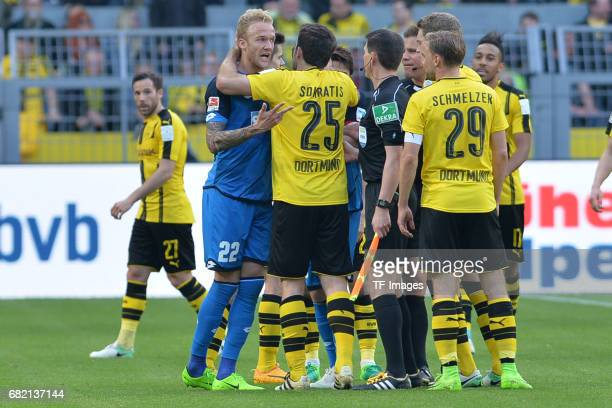 Kevin Vogt of Hoffenheim speak with Sokratis of Dortmund during the Bundesliga match between Borussia Dortmund and TSG 1899 Hoffenheim at Signal...