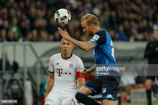 Kevin Vogt of Hoffenheim und Arjen Robben of Munich battle for the ball during the Bundesliga match between TSG 1899 Hoffenheim and Bayern Muenchen...