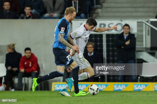 Kevin Vogt of Hoffenheim und Robert Lewandowski of Munich battle for the ball during the Bundesliga match between TSG 1899 Hoffenheim and Bayern...