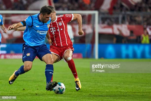 Kevin Volland and Robert Lewandowski of Muenchen battle for the ball during the Bundesliga match between FC Bayern Muenchen and Bayer 04 Leverkusen...