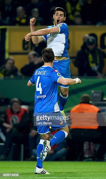 Kevin Volland of 1899 Hoffenheim celebrates after scoring his teams first goal during the DFB Cup Quarter Final match between at Borussia Dortmund...