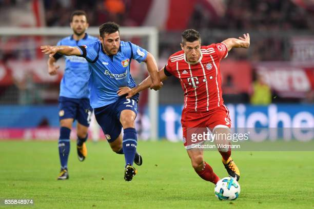 Kevin Volland of Bayer Leverkusen and Robert Lewandowski of Bayern Muenchen compete for the ball during the Bundesliga match between FC Bayern...