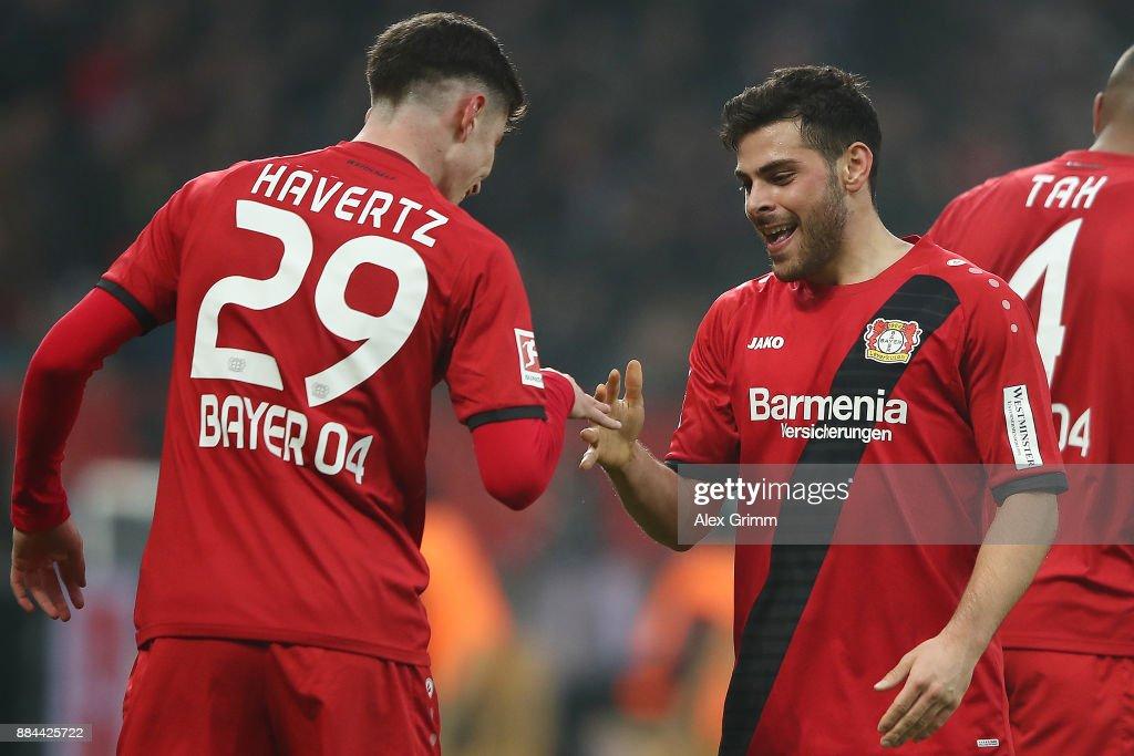 Kevin Volland of Bayer Leverkusen (2nd left) celebrates with Kai Havertz of Bayer Leverkusen after he scored a goal to make it 1:0 during the Bundesliga match between Bayer 04 Leverkusen and Borussia Dortmund at BayArena on December 2, 2017 in Leverkusen, Germany.