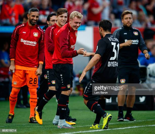Kevin Volland of Bayer Leverkusen celebrates with team mates after scoring his teams first goal during the Bundesliga match between Bayer 04...