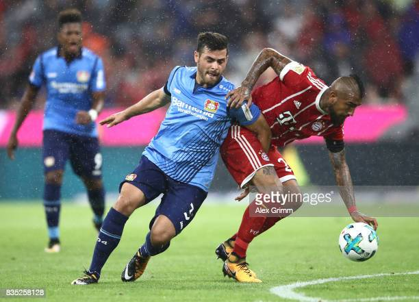 Kevin Volland of Bayer Leverkusen with Arturo Vidal of Bayern Muenchen during the Bundesliga match between FC Bayern Muenchen and Bayer 04 Leverkusen...