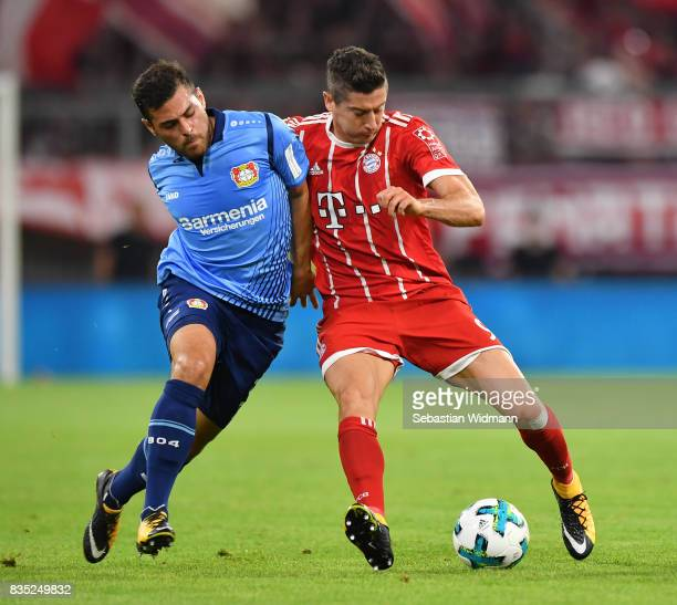 Kevin Volland of Bayer Leverkusen with Robert Lewandowski of Bayern Muenchen during the Bundesliga match between FC Bayern Muenchen and Bayer 04...