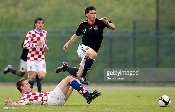 Kevin Volland of Germany and Diego Zivulic of Croatia battle for the ball during the U18 international friendly match between Croatia and Germany at...