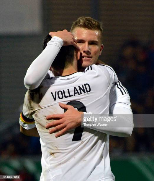 Kevin Volland of Germany celebrates with a teammate after scoring his team's second goal during the U21 Euro qualifier group 6 match between Germany...