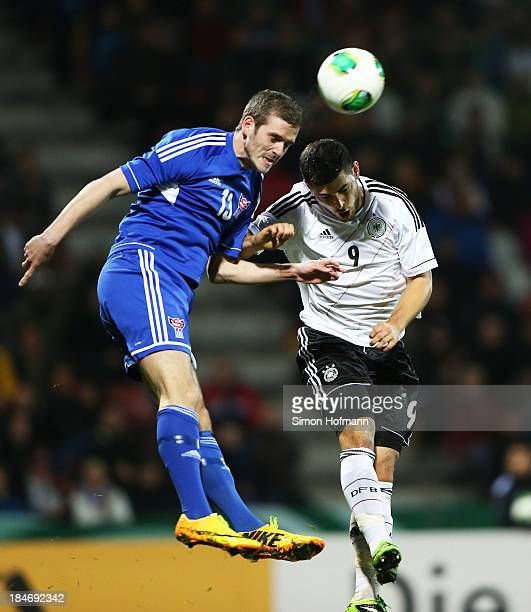 Kevin Volland of Germany jumps for a header with Pal Mohr Joensen of Faroe Islands during the 2015 UEFA European U21 Championships Qualifying Group...