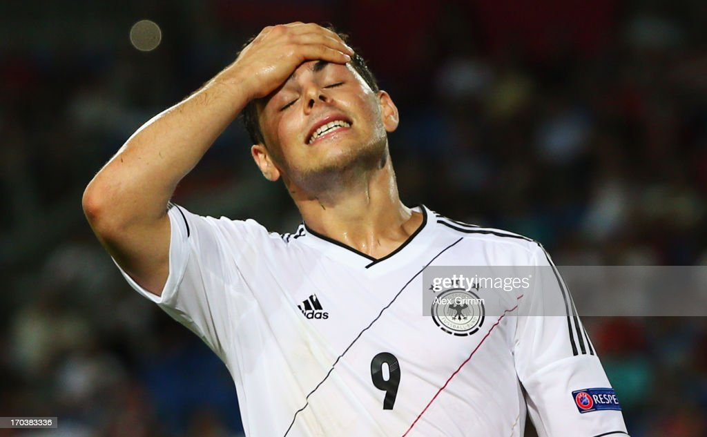 <a gi-track='captionPersonalityLinkClicked' href=/galleries/search?phrase=Kevin+Volland&family=editorial&specificpeople=6001755 ng-click='$event.stopPropagation()'>Kevin Volland</a> of Germany reacts during the UEFA European U21 Championship Group B match between Russia and Germany at Netanya Stadium on June 12, 2013 in Netanya, Israel.