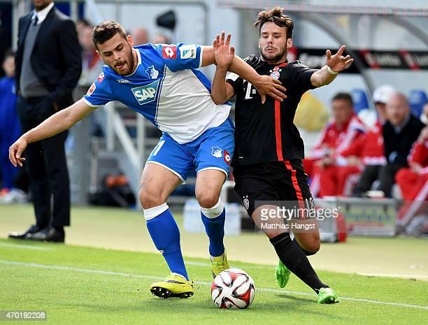 Kevin Volland of Hoffenheim battles for the ball with Juan Bernat of Muenchen during the Bundesliga match between 1899 Hoffenheim and FC Bayern...